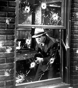 Paul Muni with a machine gun in Scarface